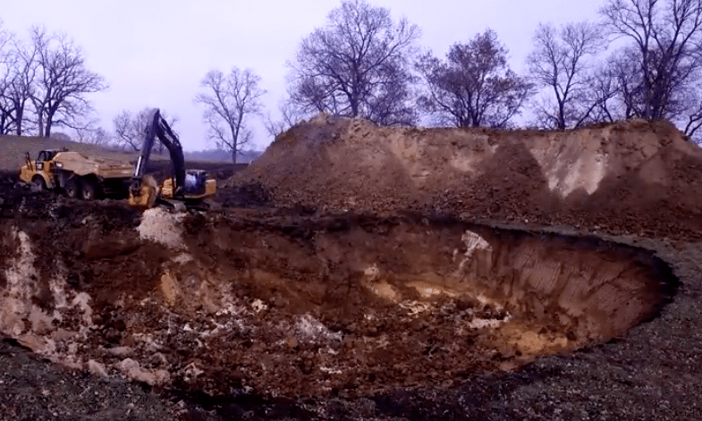 Truck digging a hole