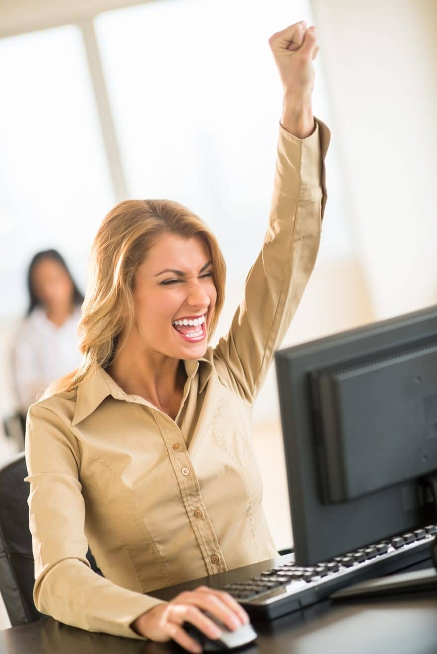 Woman happy at her desk