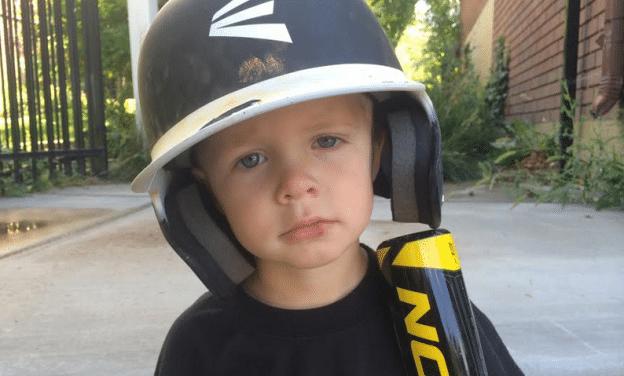 Kid in baseball gear