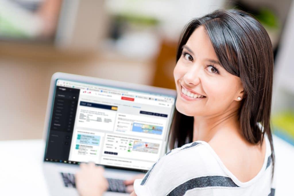 A woman using Tailwind Transportation Software