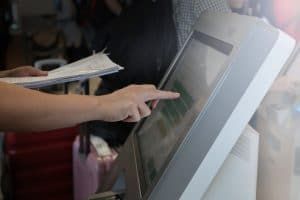 Man doing self-registration for flight with E-ticket