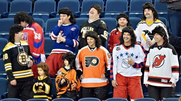 Guys watching hockey wearing mullets