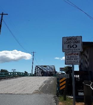 A bridge with a load limit sign