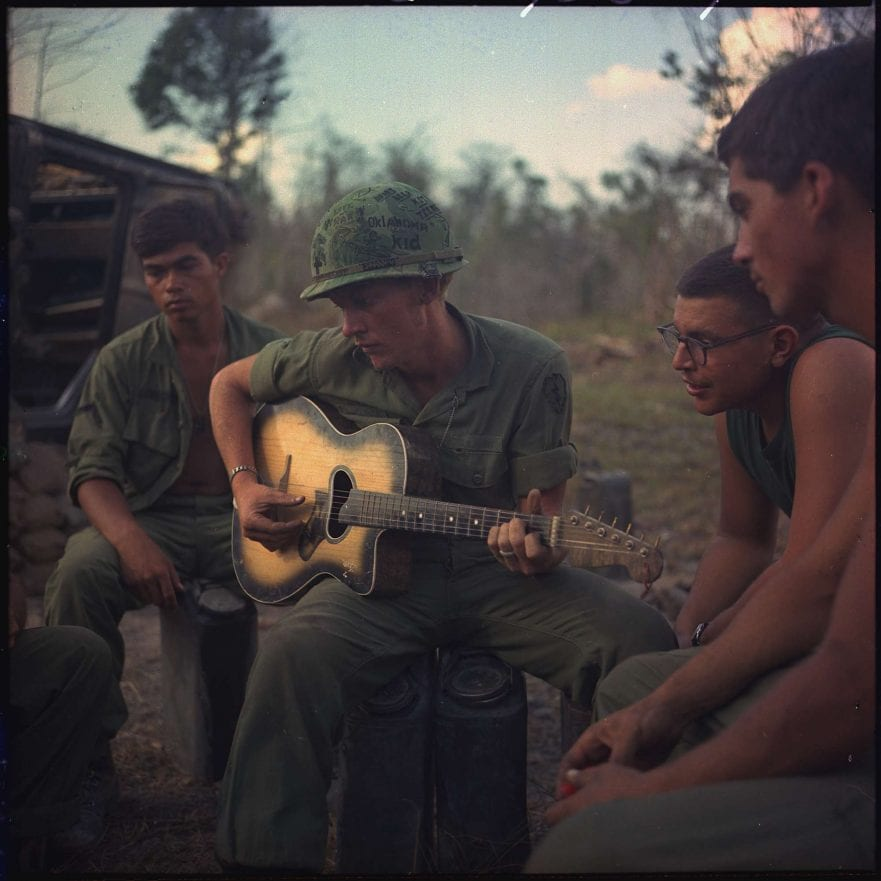 Vietnam war image of a soldier playing the guitar